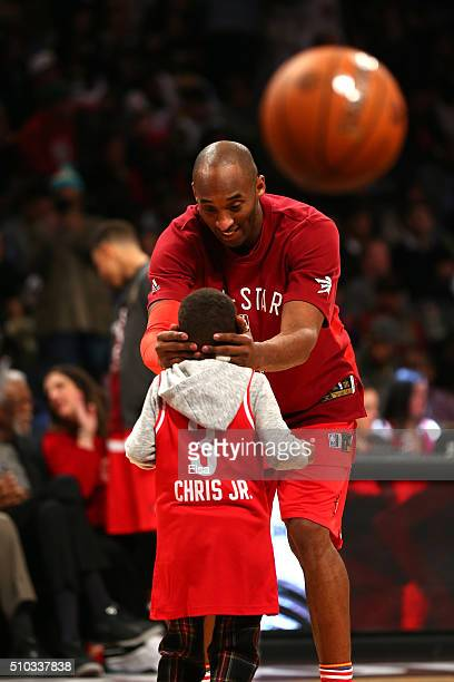 Kobe Bryant of the Los Angeles Lakers and the Western Conference plays with Chris Paul Jr son of Chris Paul of the Los Angeles Clippers and the...