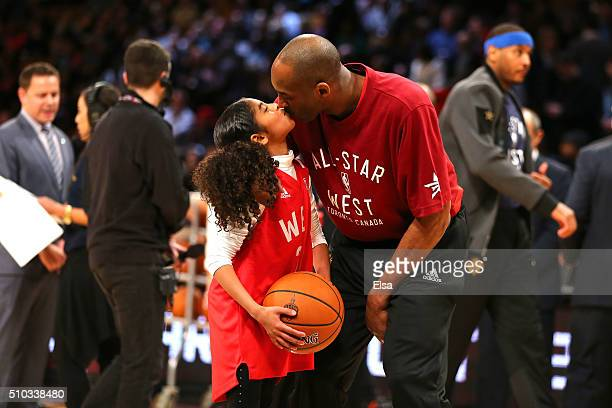 Kobe Bryant of the Los Angeles Lakers and the Western Conference kisses daughter Gianna Bryant during the NBA All-Star Game 2016 at the Air Canada...