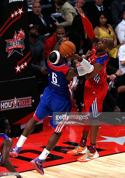 Kobe Bryant of the Los Angeles Lakers and the Western Conference blocks the shot of LeBron James of the Miami Heat and the Eastern Conference in the...