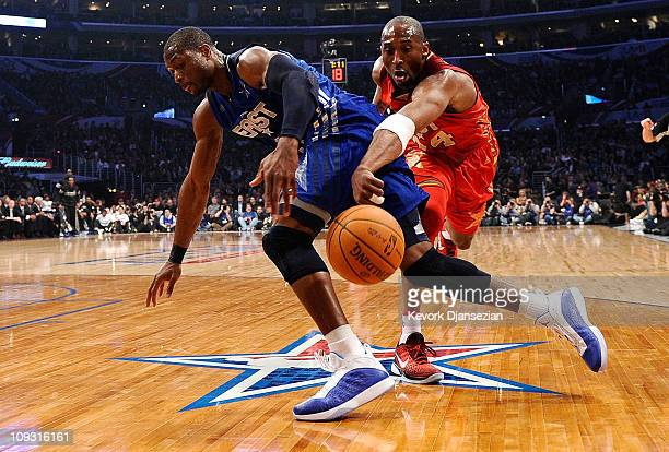 Kobe Bryant of the Los Angeles Lakers and the Western Conference attempts to steal the ball from Dwyane Wade of the Miami Heat and the Eastern...
