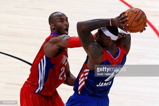 Kobe Bryant of the Los Angeles Lakers and the Western Conference attempts to steal the ball from LeBron James of the Miami Heat and the Eastern...