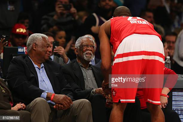 Kobe Bryant of the Los Angeles Lakers and the Western Conference speaks to NBA Hall of Famers Oscar Robertson and Bill Russell before the NBA...