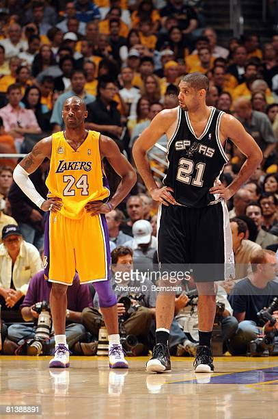 Kobe Bryant of the Los Angeles Lakers and Tim Duncan of the San Antonio Spurs wait in the back court waiting for play to resume in Game Five of the...
