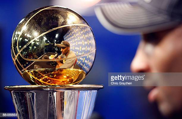 Kobe Bryant of the Los Angeles Lakers answers questions during the news conference with the Bill Russell MVP trophy after the Lakers defeated the...