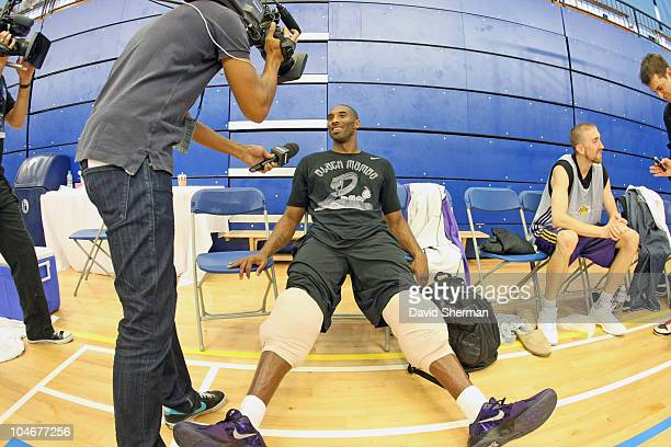 Kobe Bryant of the Los Angeles Lakers answers questions from the media following practice during 2010 NBA Europe Live on October 3 2010 at the...