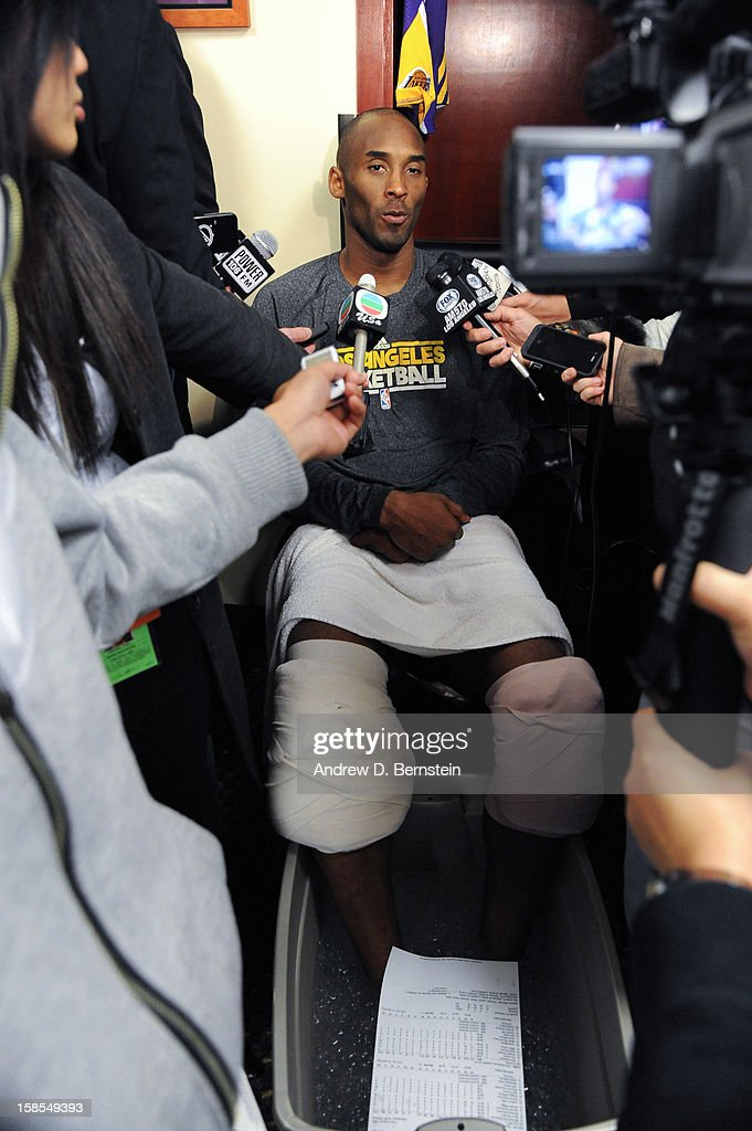 Kobe Bryant #24 of the Los Angeles Lakers answers questions from the media following his team's victory against the Charlotte Bobcats at Staples Center on December 18, 2012 in Los Angeles, California.