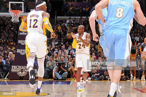 Kobe Bryant of the Los Angeles Lakers applauds during a game against the Denver Nuggets at Staples Center on January 6 2013 in Los Angeles California...