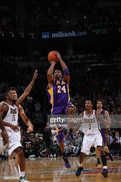 Kobe Bryant of the Los Angeles Lakers attempts a buzzer beater against John Salmons of the Milwaukee Bucks at the end of the first half of the NBA...