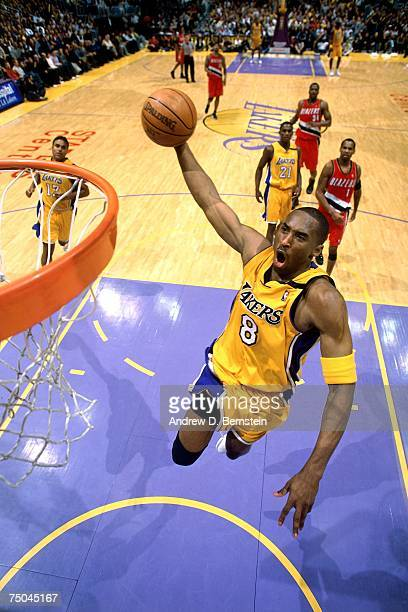 Kobe Bryant of the Los Angeles Lakers attempts a dunk against the Portland Trail Blazers during a 2003 NBA game at the Staples Center in Los Angeles...