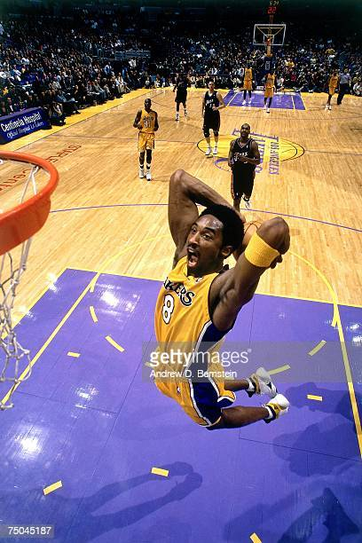Kobe Bryant of the Los Angeles Lakers attempts a dunk against the Utah Jazz during a 2000 NBA game at the Staples Center in Los Angeles California...
