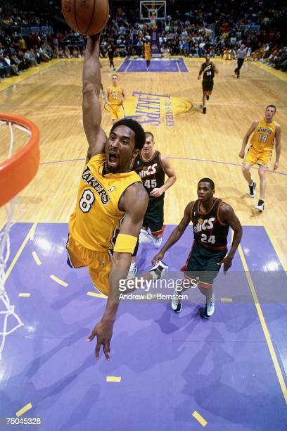 Kobe Bryant of the Los Angeles Lakers attempts a dunk against the Seattle SuperSonics during a 2001 NBA game at the Staples Center in Los Angeles,...