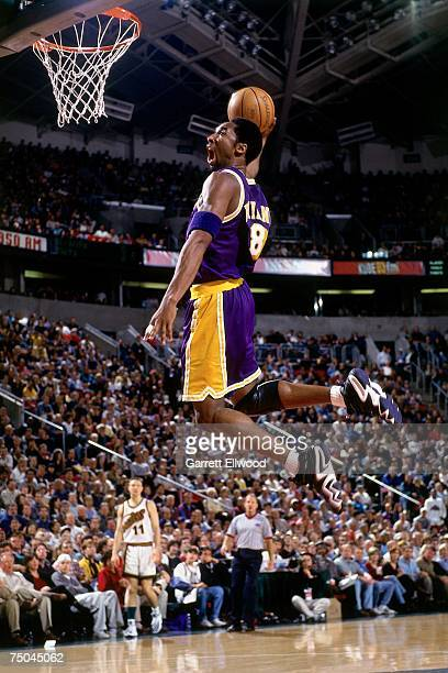 Kobe Bryant of the Los Angeles Lakers attempts a dunk during a 1999 NBA game at the Key Arena in Seattle, Washington. NOTE TO USER: User expressly...