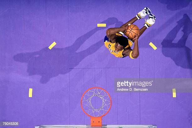 Kobe Bryant of the Los Angeles Lakers attempts a dunk during a 2000 NBA game at the Staples Center in Los Angeles California NOTE TO USER User...