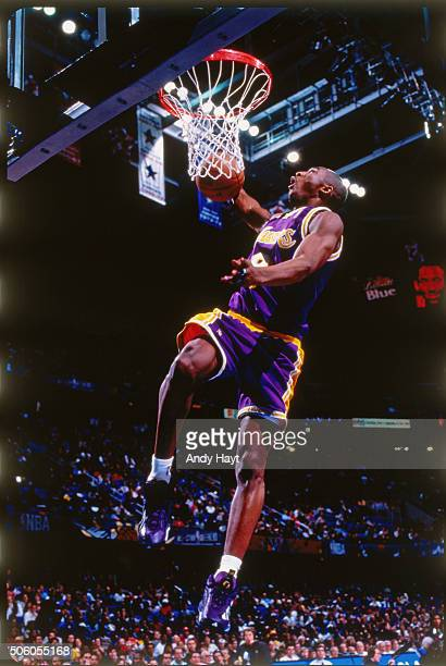 Kobe Bryant of the Los Angeles Lakers attempts a dunk during the 1997 Slam Dunk Contest on February 8 1997 at Gund Arena in Cleveland Ohio NOTE TO...