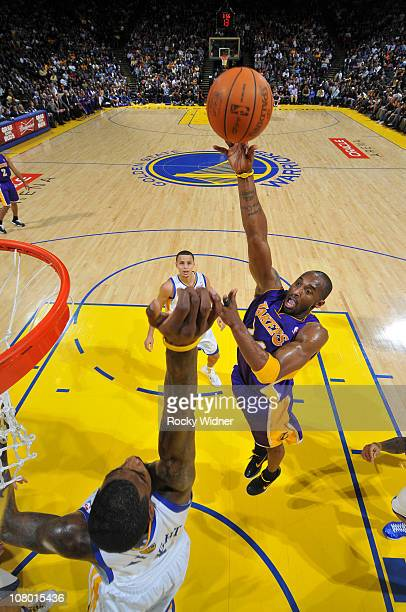 Kobe Bryant of the Los Angeles Lakers attempts a hook shot over Dorell Wright of the Golden State Warriors on January 12, 2011 at Oracle Arena in...