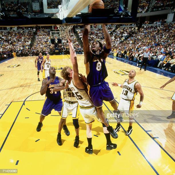 Kobe Bryant of the Los Angeles Lakers attempts a layup against Rick Smits of the Indiana Pacers during Game Four of the 2000 NBA Finals played June...