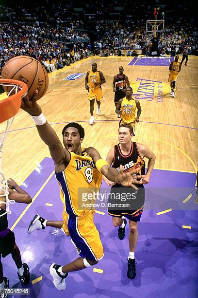 Kobe Bryant of the Los Angeles Lakers attempts a layup against the Phoenix Suns during a 2000 NBA game at the Staples Center in Los Angeles...