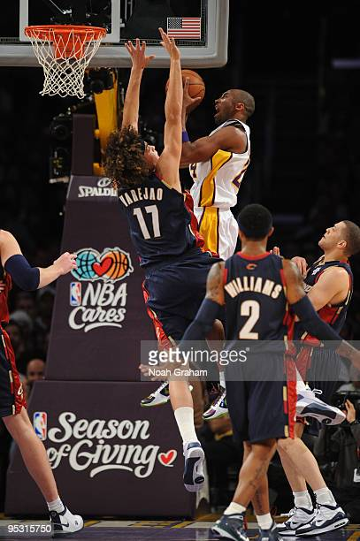 Kobe Bryant of the Los Angeles Lakers attempts a shot against Anderson Varejao of the Cleveland Cavaliers at Staples Center on December 25 2009 in...