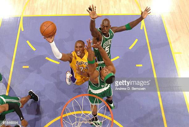 Kobe Bryant of the Los Angeles Lakers attempts a shot against the defense of Kevin Garnett of the Boston Celtics in Game Four of the 2008 NBA Finals...
