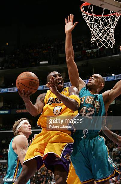 Kobe Bryant of the Los Angeles Lakers attempts a shot as PJ Brown of the New Orleans Hornets tries to block him in the second half of the game won by...