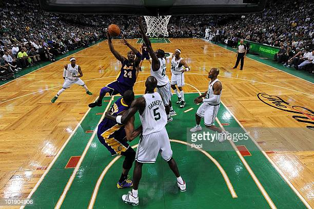 Kobe Bryant of the Los Angeles Lakers attempts a shot in the first half against Kevin Garnett of the Boston Celtics in Game Three of the 2010 NBA...
