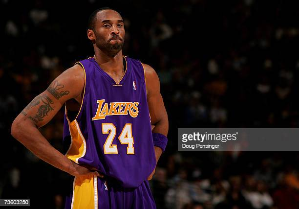 Kobe Bryant of the Los Angeles Lakers awaits action against the Denver Nuggets as the Nuggets defeated the Lakers during NBA action at the Pepsi...