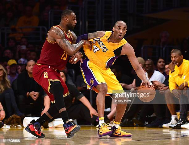 Kobe Bryant of the Los Angeles Lakers backs in on LeBron James of the Cleveland Cavaliers during the first half at Staples Center on March 10 2016 in...
