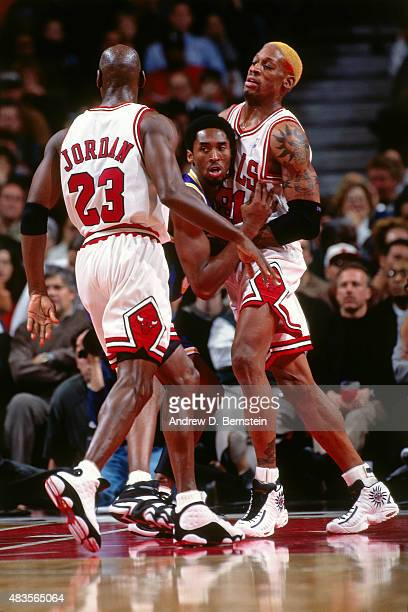 Kobe Bryant of the Los Angeles Lakers battles for position against Michael Jordan and Dennis Rodman of the Chicago Bulls on December 17 1997 at...