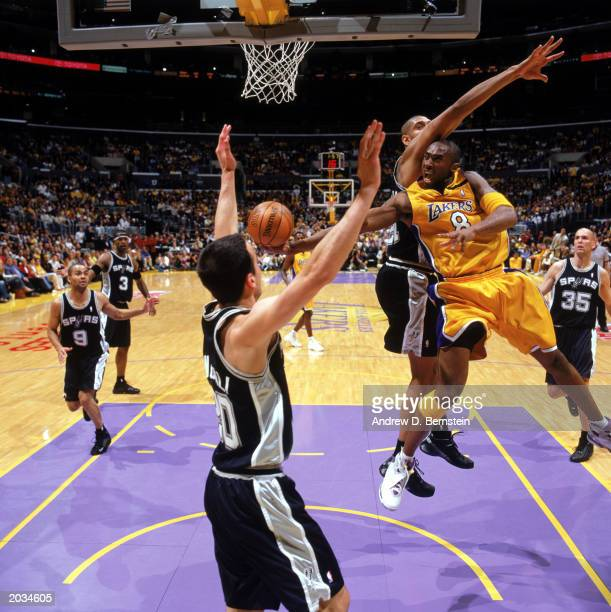 Kobe Bryant of the Los Angeles Lakers battles to shoot against Tim Duncan of the San Antonio Spurs in Game Three of the Western Conference Semifinals...