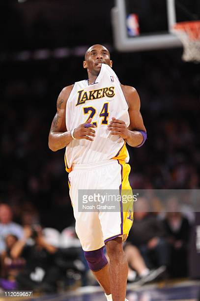 Kobe Bryant of the Los Angeles Lakers bites his jersey during a game against the Oklahoma City Thunder at Staples Center on April 10 2011 in Los...