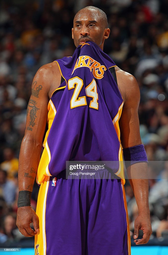 buy popular 18ecf c7fbb Kobe Bryant of the Los Angeles Lakers bites his jersey with ...