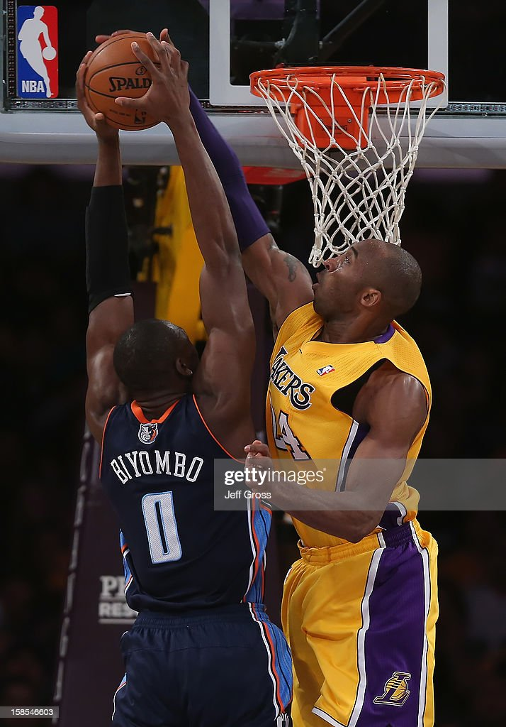 Kobe Bryant #24 of the Los Angeles Lakers blocks a shot by Bismack Biyombo #0 of the Charlotte Bobcats in the first half at Staples Center on December 18, 2012 in Los Angeles, California.