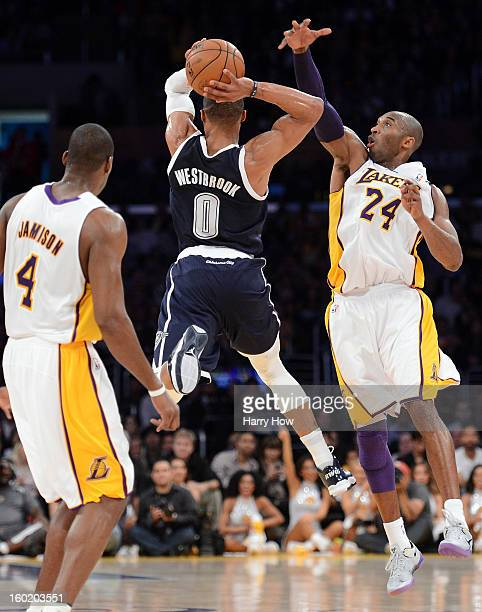Kobe Bryant of the Los Angeles Lakers blocks the last second shot attempt of Russell Westbrook of the Oklahoma City Thunder during the first quarter...