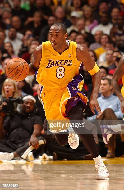 Kobe Bryant of the Los Angeles Lakers brings the ball up court against the Dallas Mavericks December 20 2005 at Staples Center in Los Angeles...