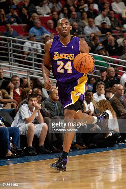 Kobe Bryant of the Los Angeles Lakers brings the ball upcourt during the game against the Orlando Magic at Amway Arena on December 27 2006 in Orlando...
