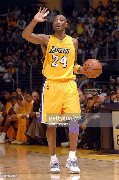 Kobe Bryant of the Los Angeles Lakers calls a play as he moves the ball up court during the game against the Oklahoma City Thunder at Staples Center...