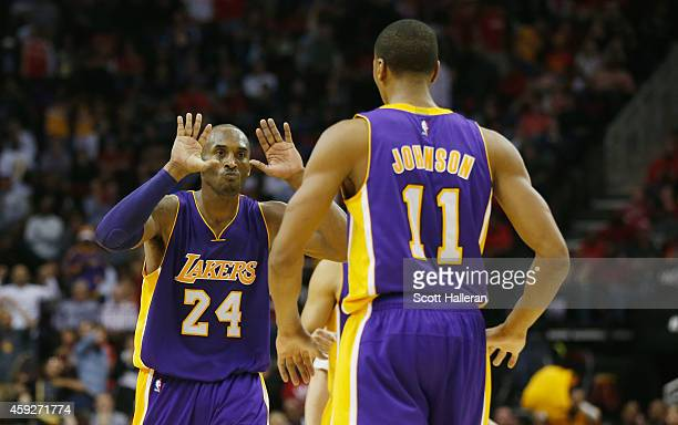 Kobe Bryant of the Los Angeles Lakers celebrates a play with Wesley Johnson their game against the Houston Rockets at the Toyota Center on November...