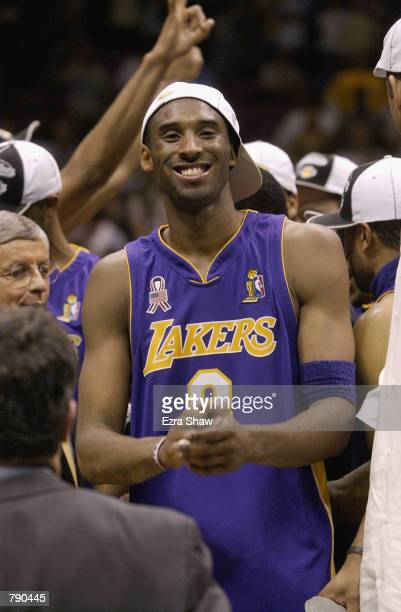 Kobe Bryant of the Los Angeles Lakers celebrates after defeating the New Jersey Nets in Game four of the 2002 NBA Finals at Continental Airlines...