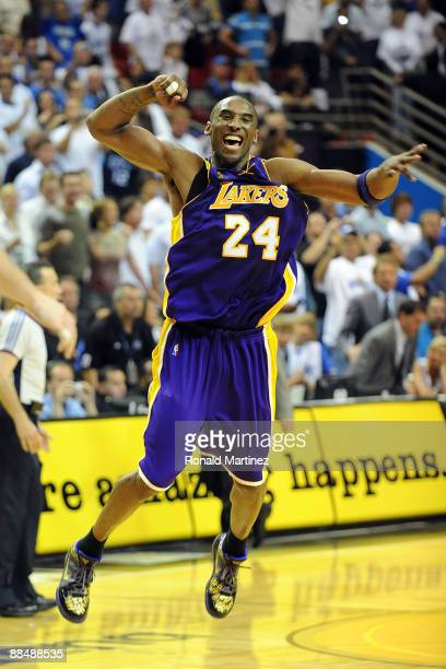 Kobe Bryant of the Los Angeles Lakers celebrates after defeating the Orlando Magic 99-86 in Game Five of the 2009 NBA Finals on June 14, 2009 at...