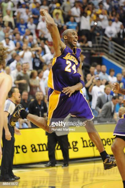 Kobe Bryant of the Los Angeles Lakers celebrates after defeating the Orlando Magic in Game Five of the 2009 NBA Finals on June 14 2009 at Amway Arena...