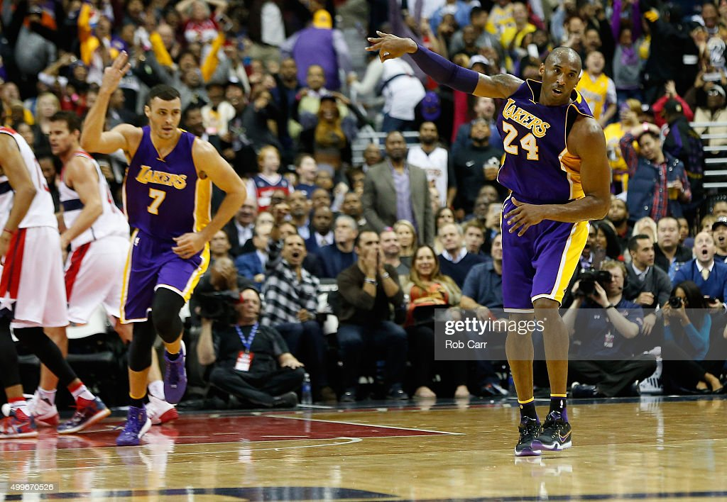 Kobe Bryant #24 of the Los Angeles Lakers celebrates after hitting a three pointer late in the fourth quarter of the Lakers 108-104 win over the Washington Wizards at Verizon Center on December 2, 2015 in Washington, DC.