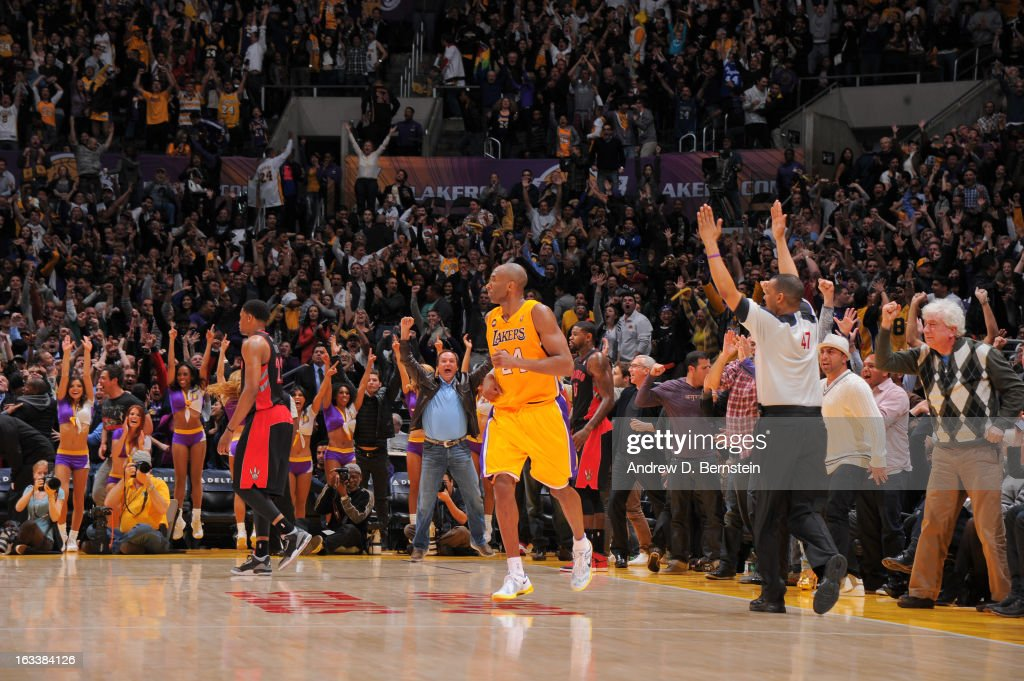 Kobe Bryant #24 of the Los Angeles Lakers celebrates after making a three-pointer to tie the game and force overtime against the Toronto Raptors at Staples Center on March 8, 2013 in Los Angeles, California.