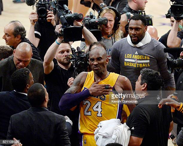 Kobe Bryant of the Los Angeles Lakers celebrates after scoring 60 points against the Utah Jazz at Staples Center on April 13 2016 in Los Angeles...