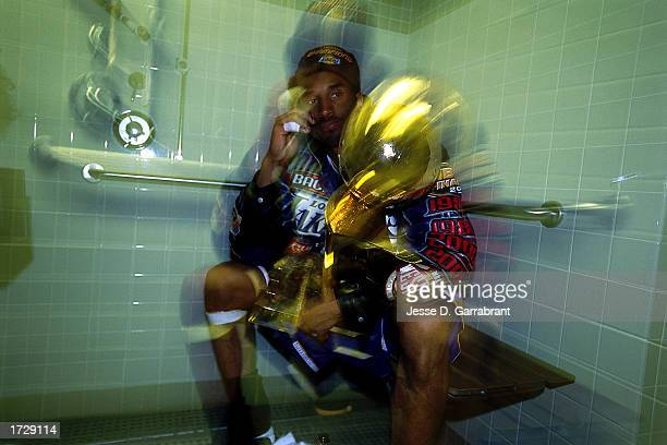 Kobe Bryant of the Los Angeles Lakers celebrates after winning the 2001 NBA Championship at the Staples Center in Los Angleles California NOTE TO...
