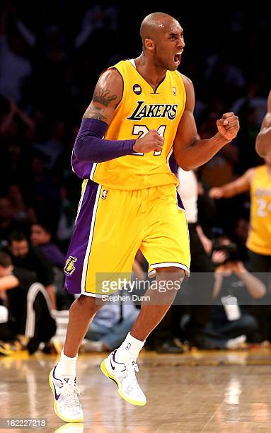 Kobe Bryant of the Los Angeles Lakers celebrates during the game against the Boston Celtics at Staples Center on February 20 2013 in Los Angeles...