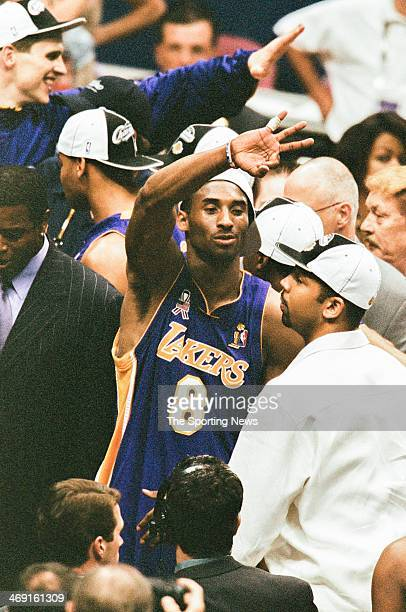 Kobe Bryant of the Los Angeles Lakers celebrates following Game Four of the NBA Finals against the New Jersey Nets on June 12 2002 at Continental...