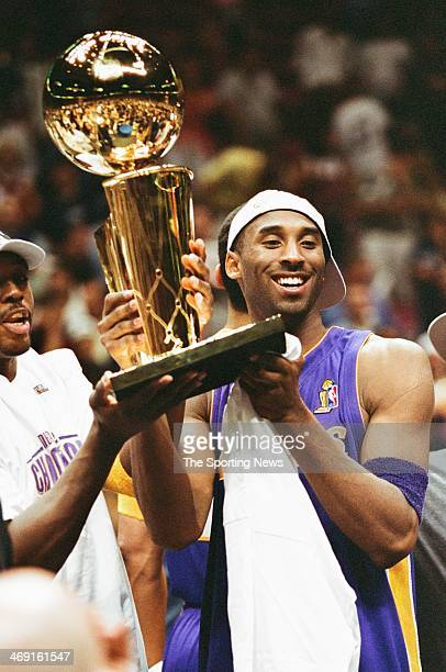Kobe Bryant of the Los Angeles Lakers celebrates following Game Four of the NBA Finals against the New Jersey Nets on June 12, 2002 at Continental...