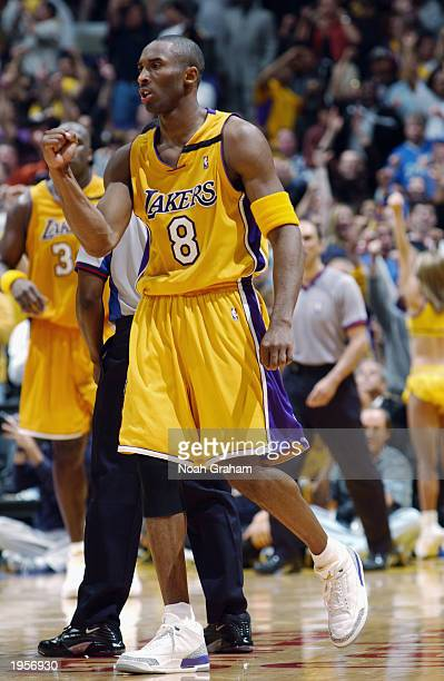 Kobe Bryant of the Los Angeles Lakers celebrates in Game three of the Western Conference Quarterfinals during the 2003 NBA Playoffs against the...