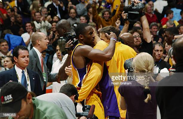 Kobe Bryant of the Los Angeles Lakers celebrates the win over the Dallas Mavericks after the NBA game at Staples Center on December 6, 2002 in Los...