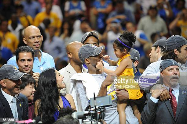 Kobe Bryant of the Los Angeles Lakers celebrates victory with his family following Game 5 of the NBA Finals against the Orlando Magic at Amway Arena...